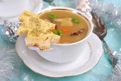 奶油色等概率圆汤用圣诞节的乳酪多士 库存图片