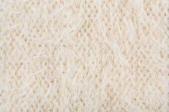 奶油色编织的纹理 库存图片