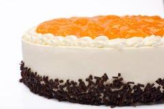 奶油色蛋糕用在白色背景的普通话 免版税图库摄影