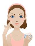 奶油色表面使用妇女年轻人 免版税库存照片