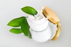 奶油色表面瓶子 免版税库存图片