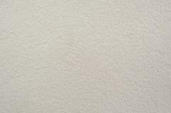 奶油色水泥墙壁纹理 免版税库存照片