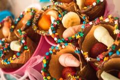 奶蛋烘饼锥体用糖果 库存照片