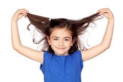 她女孩获取的头发少许 免版税图库摄影