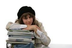 她的家庭studyies少年工作 免版税库存照片