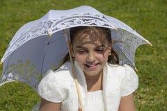 她的第一个圣餐的女孩 免版税库存图片
