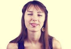 她的纵向相当定了调子舌头妇女 免版税库存照片