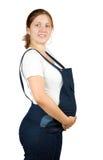 她的藏品怀孕的肚子妇女 免版税库存图片