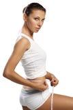 她的评定米棍子腰部妇女 免版税图库摄影