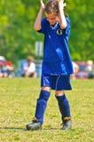 她自己疯狂的球员足球年轻人 免版税库存照片