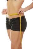 她评定的腰部妇女年轻人 免版税库存图片