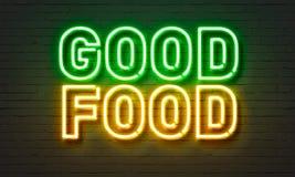 好在砖墙背景的食物霓虹灯广告 图库摄影