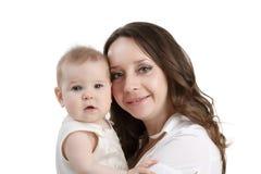 好深色头发的妇女和她可爱的女儿 库存照片