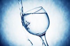 好的玻璃用水飞溅 库存图片