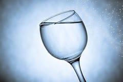 好的玻璃用水飞溅 免版税库存图片