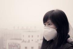 如何面对大气污染 免版税库存照片