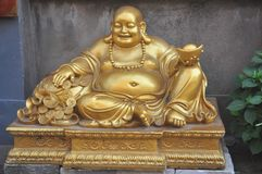 如果您走向菩萨菩萨菩萨雕象, Sakyamuni菩萨微笑面对金和银首饰 库存图片