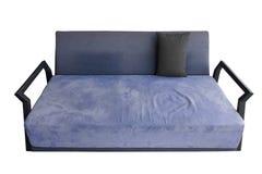 如此看舒适的青紫色沙发 免版税库存图片