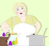 主妇在厨房里 免版税图库摄影