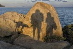 妇女、人和狗的阴影 库存照片