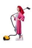 妇女与吸尘器一起使用 库存照片