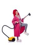 妇女与吸尘器一起使用 图库摄影