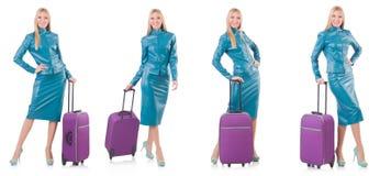 妇女为带着手提箱的假期做准备在白色 免版税图库摄影