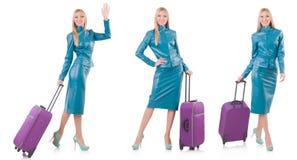 妇女为带着手提箱的假期做准备在白色 图库摄影