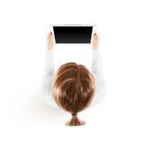 妇女举行片剂在手中个人计算机大模型,被隔绝的顶视图 库存图片