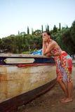 妇女乘小船 图库摄影