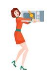 妇女买微波炉 在打折价的销售 库存图片