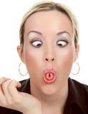 妇女做一个滑稽的表面 免版税库存图片