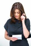 妇女做名单的办公室工作者 免版税库存照片