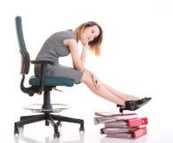 妇女停工斗争女实业家松弛腿上升大量doc 库存图片