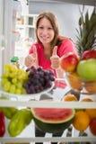 妇女健康食物的展示赞许 免版税库存图片