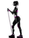妇女健身抵抗结合剪影 库存照片