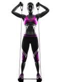 妇女健身抵抗结合锻炼剪影 免版税库存照片