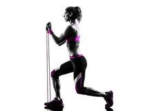 妇女健身抵抗结合锻炼剪影 库存图片