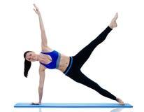 妇女健身被隔绝的pilates exercices 库存照片