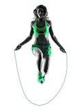妇女健身跳绳行使剪影 库存图片