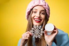妇女冬天画象有面部奶油的 免版税图库摄影
