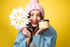 妇女冬天画象有面部奶油的 图库摄影