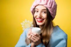 妇女冬天画象有面部奶油的 免版税库存图片