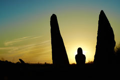 妇女剪影日落光线的 图库摄影