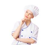 妇女厨师认为,看在旁边 免版税库存照片