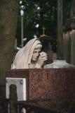 妇女古色古香的雕象坟茔的 免版税图库摄影