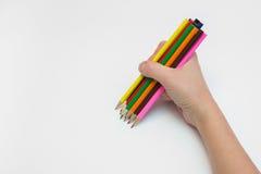 妇女右手画一十二支铅笔 免版税库存照片