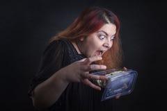 妇女吃 免版税库存图片