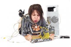 妇女吹的计算机风扇 图库摄影