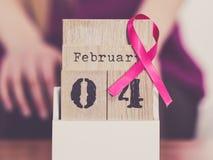 妇女和世界在日历的乳腺癌天 免版税库存照片